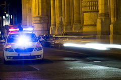 Police in action. Police car turn emergency lights on when spot a speeder. Raw file available Royalty Free Stock Images