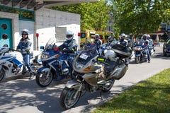 Police on amateur cycling event Marathon Franja. LJUBLJANA, SLOVENIA - JUNE 8, 2014: Traditional amateur cycling event Marathon Franja which occurs once a year royalty free stock images