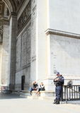 Police on Arc de Triomphe. French policeman armed with submachine gun guarding on Arc de Triomphe in Paris (France Royalty Free Stock Photo