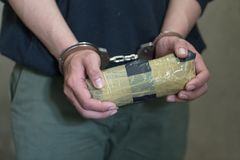 Police arrest drug trafficker with handcuffs. Law and police concept. - Image, World Anti-drug Day stock photography