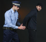 Police arrest _ officer and thief. Police officer arretign a thief Royalty Free Stock Images