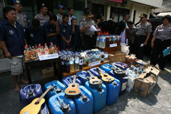 Police. Arrest sellers of traditional liquor and dozens of drunks in the city of Solo, Central Java, Indonesia,  also seized hundreds of liters of liquor harm Royalty Free Stock Photos