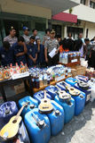 Police. Arrest sellers of traditional liquor and dozens of drunks in the city of Solo, Central Java, Indonesia,  also seized hundreds of liters of liquor harm Royalty Free Stock Photo