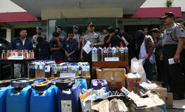 Police. Arrest sellers of traditional liquor and dozens of drunks in the city of Solo, Central Java, Indonesia,  also seized hundreds of liters of liquor harm Stock Photography