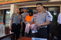 Police arrested drug dealer. Police arrested a drug dealer in a raid to suppress crime in the city of Solo, Central Java, Indonesia Royalty Free Stock Photos