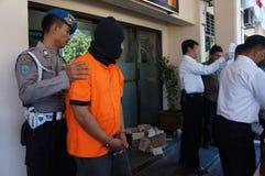 Police arrested drug dealer. Police arrested a drug dealer in a raid to suppress crime in the city of Solo, Central Java, Indonesia Stock Image