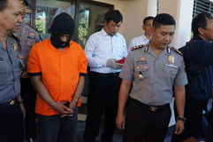 Police arrested drug dealer. Police arrested a drug dealer in a raid to suppress crime in the city of Solo, Central Java, Indonesia Royalty Free Stock Images