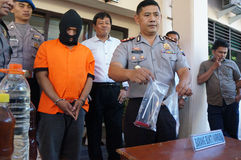 Police arrested drug dealer. Police arrested a drug dealer in a raid to suppress crime in the city of Solo, Central Java, Indonesia Royalty Free Stock Photo