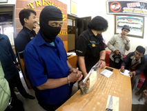Police arrested the killer. Police interrogated after the arrest perpetrators of the murder in the city of Solo, Central Java, Indonesia Stock Photography