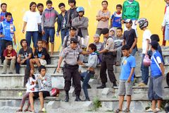 Police arrested maker a fuss. Some police arrested the one of the fans that maker a fuss in the stadium when a soccer match in Semarang Royalty Free Stock Photography