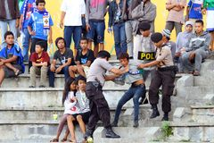 Police arrested maker a fuss. Some police arrested the one of the fans that maker a fuss in the stadium when a soccer match in Semarang Stock Image