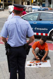 Police arresting street seller Royalty Free Stock Images