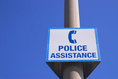 Police assistance sign. A police assistance sign with a blue sky background Royalty Free Stock Image