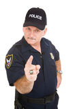 Police Authority. Angry looking police officer pointing his finger at you.  Isolated on white Stock Images