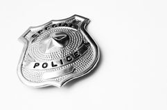 Police badge. Close-up of a police metal badge over white background Stock Photography