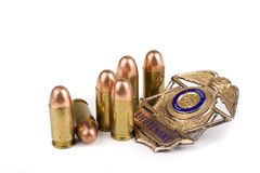 Police badge and bullets. On a white background royalty free stock image