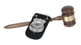 Police Badge and Gavel. Silver special police badge with a star and a Wooden Gavel - path included stock photo