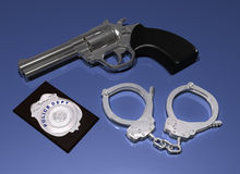 Police badge, gun and handcuffs Stock Images