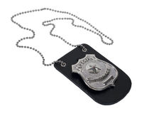 Police Badge on Leather Holder. Silver special police badge with a star on leather holder with chain - path included stock photo