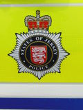 Police badge on police car. The insignia of the States of Jersey Police force on the side of a police car in Jersey in the Channel Islands stock images