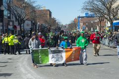 Police Bagpipers in Saint Patrick's Day parade Boston, USA royalty free stock images