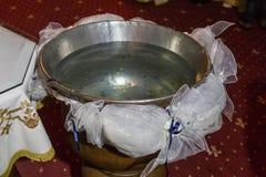 Police baptismale de l'eau sainte Photos libres de droits