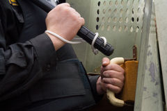 Police battering door handle. Policeman with the police bat stock photos