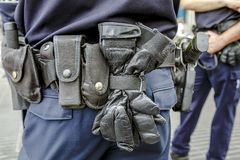 Police belt. A police officer standing in the street next to his car Stock Images