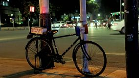 Police bicycle on the street. At the crossing in the center of night city, China stock video footage