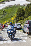 Police Bike of  Tour of France. Port de Pailheres,France- July 06 2013:Police's bike driving on the road to Col de Pailheres in Pyrenees Mountains, before the Stock Photography