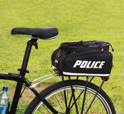 Police Bike. With a trunk bag on the rack parking on the grass Royalty Free Stock Images