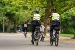 Police on bikepatrol in the Vondelpark. Police on bikepatrol in the Amsterdam Vondelpark in the Netherlands Royalty Free Stock Photo