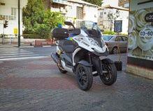 Police black-silver scooter Quadro 350 S3. Rishon Le Zion, Israel - April 7, 2015:  Police black-silver scooter Quadro 350 S3 staying on sidewalk Zhabotinsky Stock Photo