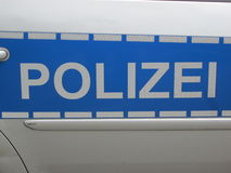 Police in blue and silverwhite (Polizei) Germany Royalty Free Stock Photography