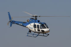 Police Bo 105 helicopter flies past Royalty Free Stock Image
