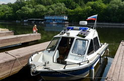Police boat at the dock Stock Photos