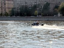 Police Boat fast hurtling on Moscow River. Royalty Free Stock Photo