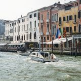 A police boat on the Grand canal in Venice. Venice, Italy - March 27th, 2018: A police boat on the Grand canal in Venice Royalty Free Stock Images