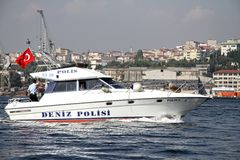 Police boat in Halic bay. Turkish police boat patrols the area of the offshore race during Fatih Grand Prix on September 25, 2010 at the Golden-Horn bay in Stock Photos