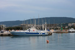 Police  boat moored in harbor in Koper after sunset time Stock Images