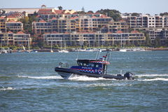 Police boat on patrol in harbour Royalty Free Stock Image