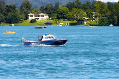 Police boat patrolling on lake Worthersee Royalty Free Stock Image