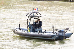 The Police boat patrolling on the Seine river, Paris, France. Royalty Free Stock Images