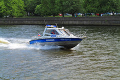 The police boat rushes down the river Stock Images