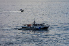 Police Boat Security. A police boat provides security  in Elliott Bay near Seattle, Washington Royalty Free Stock Images