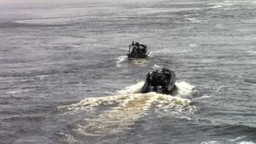 Police boats on the river. Some Police boats on the river stock footage