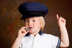 Police boy. Young toddler boy with police whistle and hat Stock Photo