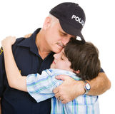 Police and Boy Hug Stock Photography
