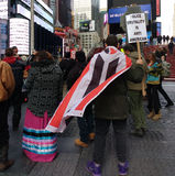 Police Brutality Is Anti American, Protesters in Times Square, New York City, NYC, NY, USA. Among the crowd at a protest against the Dakota Access Pipeline is a Royalty Free Stock Photos