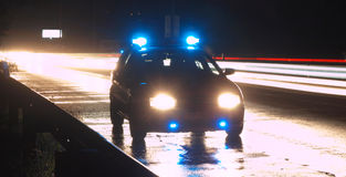 Police car. At night action with shining reflectors Royalty Free Stock Image